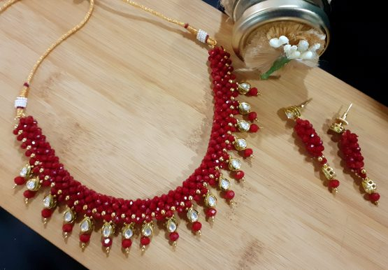 Faux Kundan Gems Necklace in Ruby