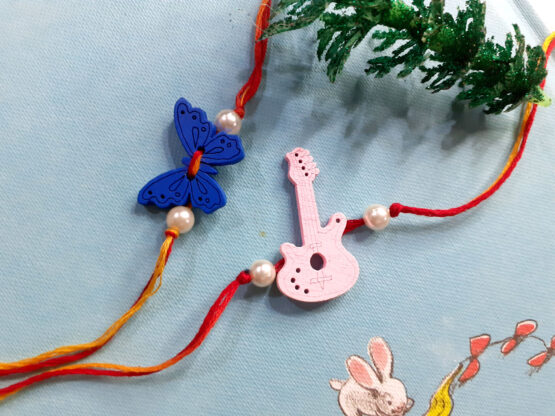 Naughty Kids buTTerFly and gUItAr Rakhi Combo Set (Pack of 2)